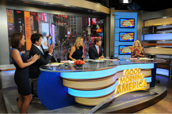 "<div class=""meta ""><span class=""caption-text "">Carrie Underwood co-hosts 'Good Morning America' ('GMA') on Monday, Aug. 12, 2013. Pictured to her left, from left: Presenters Ginger Zee, Josh Elliot, Lara Spencer and George Stephanopoulos. (ABC Photo / Donna Svennevik)</span></div>"