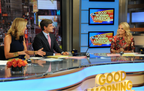 "<div class=""meta ""><span class=""caption-text "">Carrie Underwood co-hosts 'Good Morning America' ('GMA') on Monday, Aug. 12, 2013. Pictured to her left, from left: Presenters Lara Spencer and George Stephanopoulos. (ABC Photo / Donna Svennevik)</span></div>"