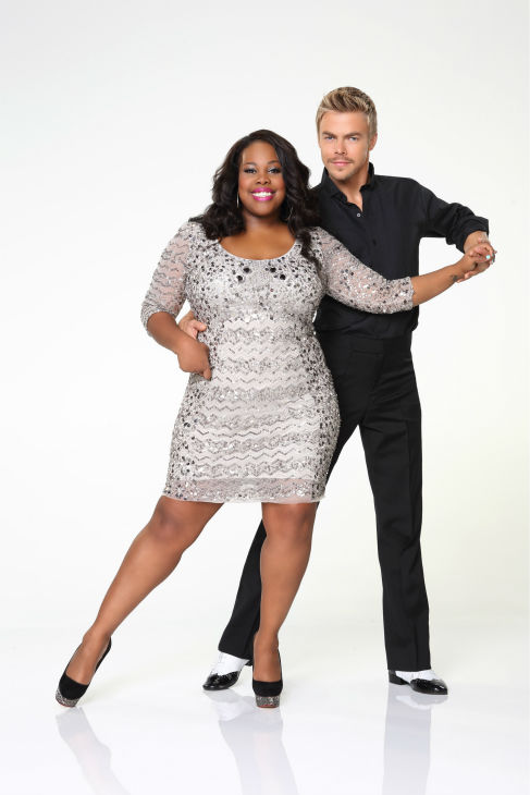 'Dancing With the Stars' season 17 cast member Amber Riley, who plays Mercedes on the FOX show 'Glee,' appears with dance partner Derek Hough in an official cast photo, ahead of the Fall 2013 premiere of the ABC show.