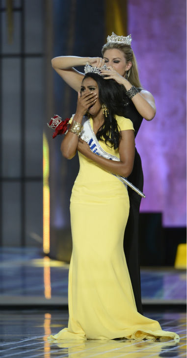 Nina Davuluri, Miss New York, is crowned Miss America 2014 by Miss America 2013, Mallory Hagan, also of New York, at the annual pageant in Atlantic City, New Jersey on Sept. 15, 2013. <span class=meta>(ABC Photo &#47; Ida Mae Astute)</span>
