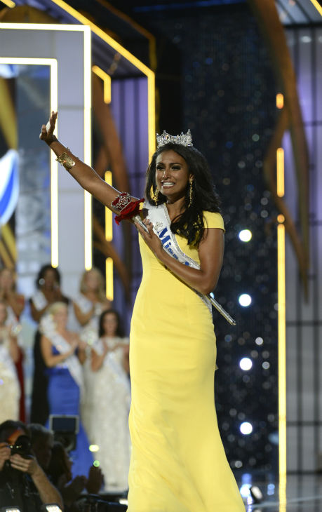 "<div class=""meta ""><span class=""caption-text "">Nina Davuluri, Miss New York, is crowned Miss America 2014 at the annual pageant in Atlantic City, New Jersey on Sept. 15, 2013. (ABC Photo/ Ida Mae Astute)</span></div>"