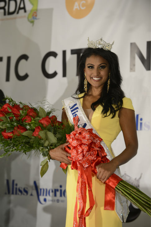 "<div class=""meta ""><span class=""caption-text "">Nina Davuluri, Miss New York, holds a bouquet after being crowned Miss America 2014 at the annual pageant in Atlantic City, New Jersey on Sept. 15, 2013. (ABC Photo / Ida Mae Astute)</span></div>"