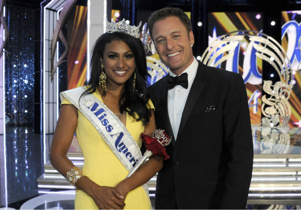 "<div class=""meta ""><span class=""caption-text "">Nina Davuluri, Miss New York and the new Miss America 2014 poses with 'Bachelor' star Chris Harrison, co-host of the annual pageant, after the event in Atlantic City, New Jersey on Sept. 15, 2013. (ABC Photo / Ida Mae Astute)</span></div>"