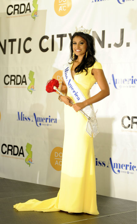 "<div class=""meta ""><span class=""caption-text "">Nina Davuluri, Miss New York and the new Miss America 2014 appears after the annual pageant in Atlantic City, New Jersey on Sept. 15, 2013. (ABC Photo / Ida Mae Astute)</span></div>"