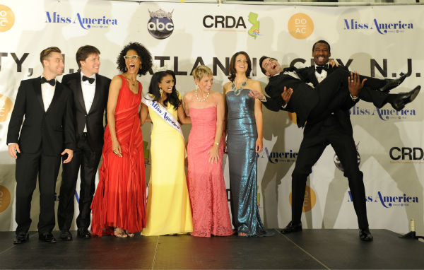 Nina Davuluri, Miss New York and the new Miss America 2014 appears with judges Lance Bass, Joshua Bell, Barbara Corcoran, Deidre Downs Gunn, Mario Cantone and Amar'e Stoudemire after the annual pageant in Atlantic City, New Jersey on Sept. 15, 2013.