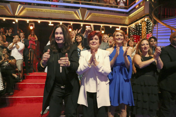 'Dancing With The Stars' competitor Jack Osbourne's parents, rocker Ozzy Osbourne and Sharon Osbourne, and wife Lisa Stelly cheer him on during a live taping of the season 17 debut of the ABC dance show in Los Angeles on Sept. 16, 2013.