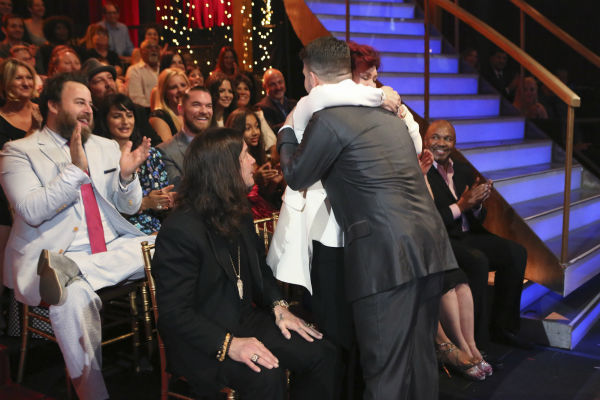 'Dancing With The Stars' competitor Jack Osbourne is hugged by mother Sharon Osbourne, while father and rocker Ozzy Osbourne watches during a live taping of the season 17 debut.