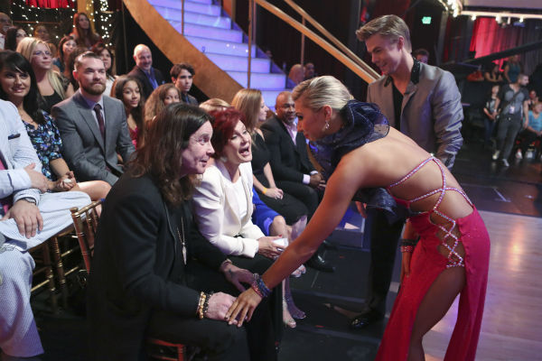 &#39;Dancing With The Stars&#39; competitor Jack Osbourne&#39;s parents, rocker Ozzy Osbourne and Sharon Osbourne, talk to pro-dancers Derek Hough and Emma Slater as they sit in the studio audience during a live taping of the season 17 debut of the ABC dance show in Los Angeles on Sept. 16, 2013. <span class=meta>(ABC Photo &#47; Adam Taylor)</span>