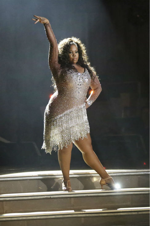 "<div class=""meta image-caption""><div class=""origin-logo origin-image ""><span></span></div><span class=""caption-text"">Amber Riley dances the Cha Cha Cha on week one of 'Dancing With The Stars' on Sept. 16, 2013. She and partner Derek Hough received 27 out of 30 points from the judges. (ABC Photo / Adam Taylor)</span></div>"