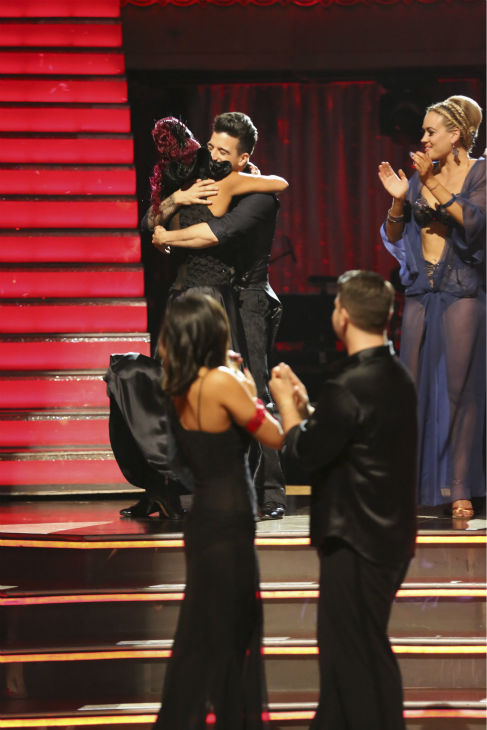 "<div class=""meta image-caption""><div class=""origin-logo origin-image ""><span></span></div><span class=""caption-text"">Christina Milian and Mark Ballas react to being safe on week 2 of 'Dancing With The Stars' on Sept. 23, 2013. They received 25 out of 30 points from the judges for their Paso Doble. (ABC Photo / Adam Taylor)</span></div>"