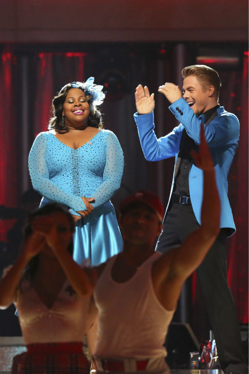 "<div class=""meta image-caption""><div class=""origin-logo origin-image ""><span></span></div><span class=""caption-text"">Amber Riley and Derek Hough react to being safe on week 2 of 'Dancing With The Stars' on Sept. 23, 2013. They received 24 out of 30 points from the judges for their Jive. (ABC Photo / Adam Taylor)</span></div>"