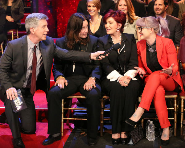 &#39;Dancing With The Stars&#39; competitor Jack Osbourne&#39;s parents, rocker Ozzy Osbourne and Sharon Osbourne, and sister Kelly Oscourne are interviewed by the ABC show&#39;s co-host Tom Bergeron as they sit in the studio audience during a live taping of week three of season 17 of the ABC dance show in Los Angeles on Sept. 16, 2013. <span class=meta>(ABC Photo &#47; Adam Taylor)</span>