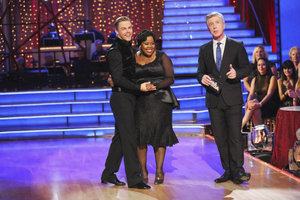 "<div class=""meta ""><span class=""caption-text "">Amber Riley and Derek Hough await their fate on week four of 'Dancing With The Stars' on Oct. 7, 2013. They received 27 out of 30 points from the judges for their Tango. (ABC Photo / Adam Taylor)</span></div>"