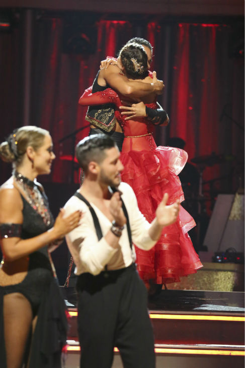 "<div class=""meta ""><span class=""caption-text "">Corbin Bleu and Karina Smirnoff react to being safe on week four of 'Dancing With The Stars' on Oct. 7, 2013. They received 27 out of 30 points from the judges for their Paso Doble. (Pictured left: Elizabeth Berkley and partner Val Chmerkovskiy.') (ABC Photo / Adam Taylor)</span></div>"
