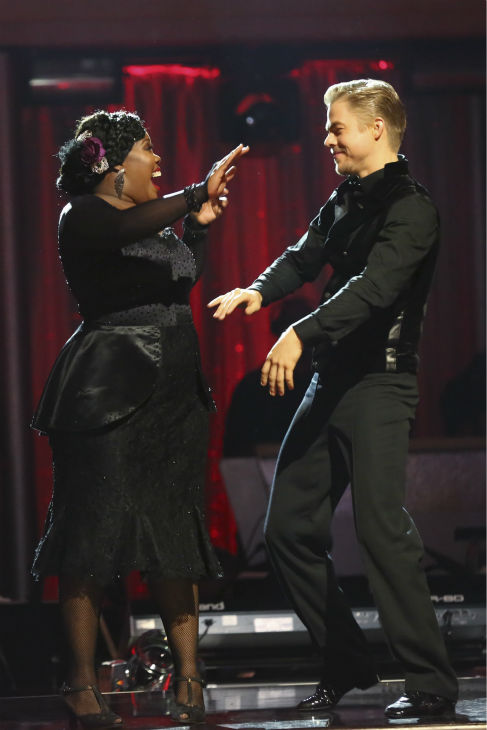 "<div class=""meta ""><span class=""caption-text "">Amber Riley and Derek Hough react to being safe on week four of 'Dancing With The Stars' on Oct. 7, 2013. They received 27 out of 30 points from the judges for their Tango. (ABC Photo / Adam Taylor)</span></div>"