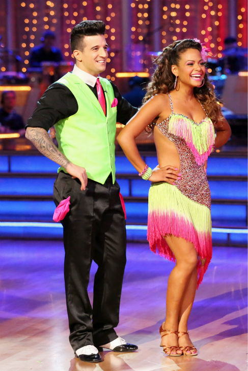 "<div class=""meta ""><span class=""caption-text "">Christina Milian and Mark Ballas await their fate on week five of 'Dancing With The Stars' on Oct. 14, 2013. They received 28 out of 30 points from the judges for their Cha Cha Cha. (ABC Photo / Adam Taylor)</span></div>"