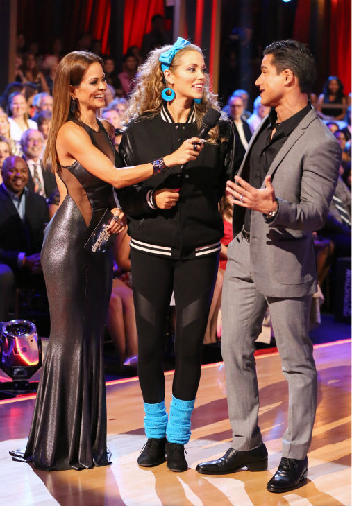 Elizabeth Berkley appears with fellow &#39;Saved By The Bell&#39; alum Mario Lopez and co-host Brooke Burke-Charvet on week five of &#39;Dancing With The Stars&#39; on Oct. 14, 2013. Berkley and partner Val Chmerkovskiy recreated reenacted one of Berkley&#39;s noteworthy scenes from &#39;Saved By The Bell.&#39; <span class=meta>(ABC Photo &#47; Adam Taylor)</span>
