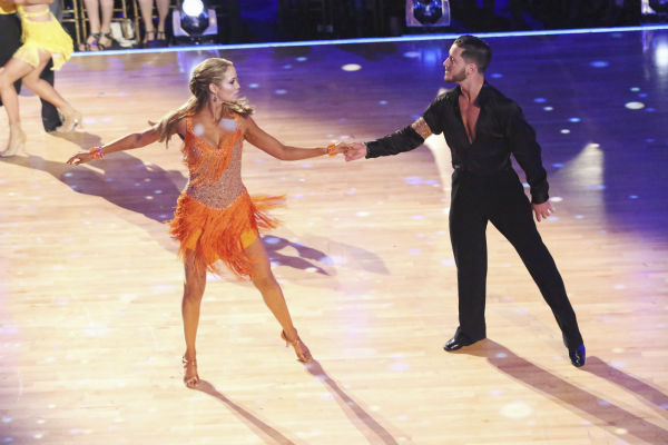 Elizabeth Berkley and Val Chmerkovskiy dance during the &#39;Switch-Up Challenge&#39; on week six of &#39;Dancing With The Stars&#39; on Oct. 21, 2013. They received 2 out of 4 extra points for it and earlier were given 30 out of 30 points for their Cha Cha Cha. <span class=meta>(ABC &#47; Adam Taylor)</span>
