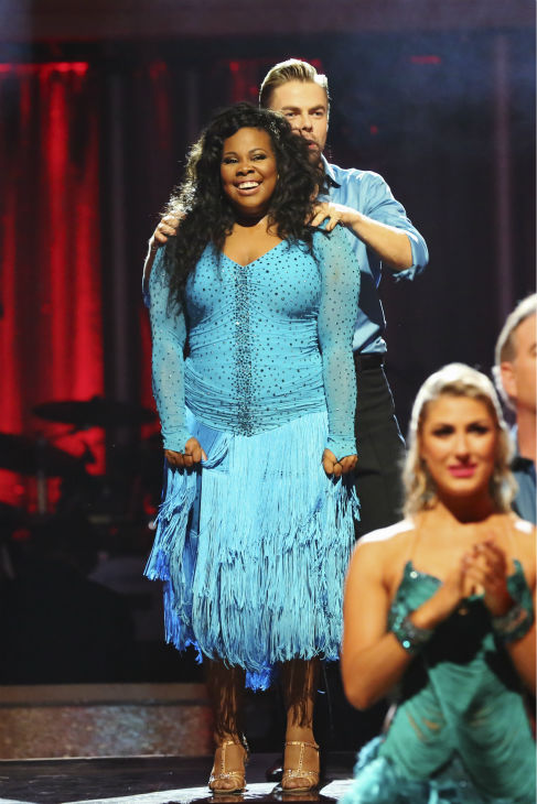 Amber Riley and Derek Hough await their fate on week six of &#39;Dancing With The Stars&#39; on Oct. 21, 2013. They received 28 out of 30 points from the judges for their Samba. The two received 4 out of 4 extra points from the &#39;Switch-Up Challenge.&#39; <span class=meta>(ABC &#47; Adam Taylor)</span>