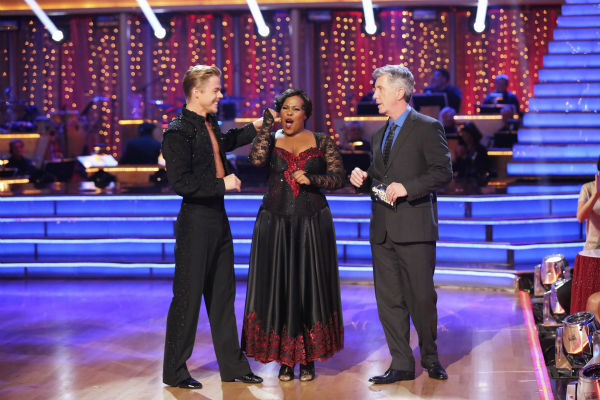 "<div class=""meta ""><span class=""caption-text "">Amber Riley and Derek Hough await their fate on week seven of 'Dancing With The Stars' on Oct. 28, 2013. They received 29 out of 30 points from the judges for their Paso Doble. The two received 30 out of 30 extra points from the Team dance. (ABC Photo / Adam Taylor)</span></div>"