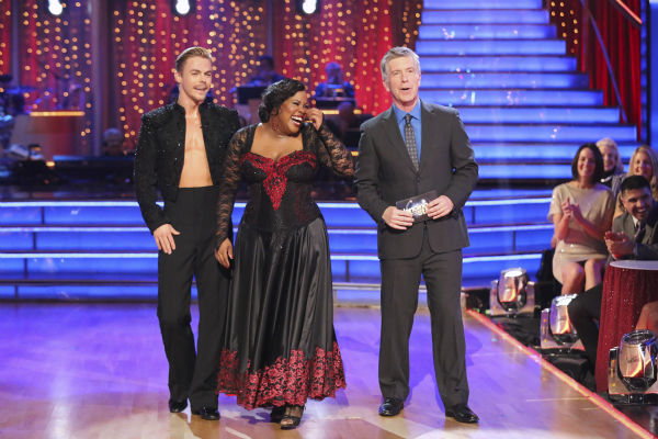 "<div class=""meta image-caption""><div class=""origin-logo origin-image ""><span></span></div><span class=""caption-text"">Amber Riley and Derek Hough react to being safe on week seven of 'Dancing With The Stars' on Oct. 28, 2013. They received 29 out of 30 points from the judges for their Paso Doble. The two received 30 out of 30 extra points from the Team dance. (ABC Photo / Adam Taylor)</span></div>"