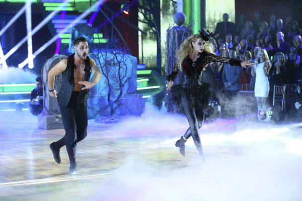Elizabeth Berkley and Val Chmerkovskiy dance freestyle in a group to &#39;Bom Bom&#39; on &#39;Dancing With The Stars&#39; on Oct. 28, 2013. <span class=meta>(ABC Photo &#47; Adam Taylor)</span>