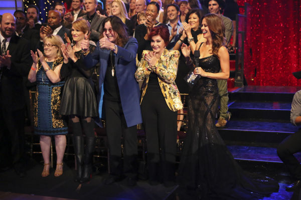&#39;Dancing With The Stars&#39; competitor Jack Osbourne&#39;s parents, rocker Ozzy Osbourne and Sharon Osbourne, and wife Lisa Stelly cheer him on during a live taping of week seven of season 17 of the ABC dance show in Los Angeles on Sept. 16, 2013. Also pictured: Co-host Brooke Burke-Charvet. <span class=meta>(ABC Photo &#47; Adam Taylor)</span>