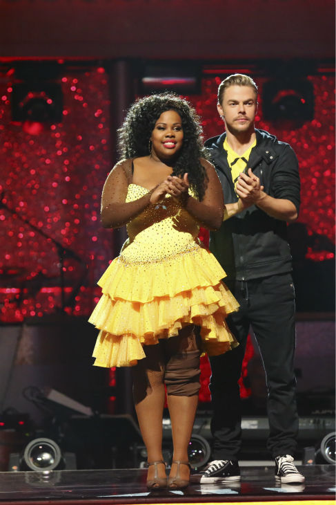 "<div class=""meta image-caption""><div class=""origin-logo origin-image ""><span></span></div><span class=""caption-text"">Amber Riley and Derek Hough await their fate on week nine of 'Dancing With The Stars' on Nov. 11, 2013. They received 28 out of 30 points from the judges for their Quickstep. The two later received 27 out of 30 for during the trio round with Mark Ballas. (ABC Photo / Adam Taylor)</span></div>"