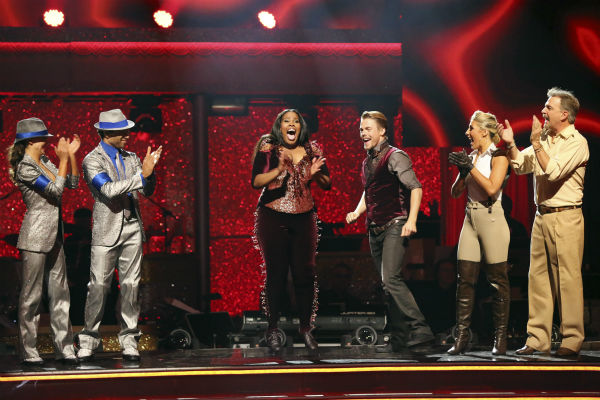 "<div class=""meta image-caption""><div class=""origin-logo origin-image ""><span></span></div><span class=""caption-text"">Amber Riley and Derek Hough react to making the finals on week 11 of 'Dancing With The Stars' on Nov. 25, 2013. The two scored a total of 64 out of 65 points for the night. (ABC Photo / Adam Taylor)</span></div>"
