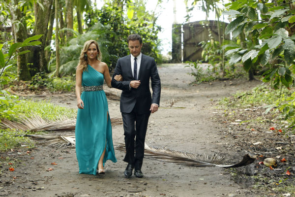 Clare, one of two remaining finalists, walks with host Chris Harrison in St. Lucia in a scene from the season 18 finale of ABC&#39;s &#39;The Bachelor,&#39; which aired on March 10, 2014. They are making their way to a podium, where she is expecting a proposal. <span class=meta>(ABC Photo &#47; Rick Rowell)</span>