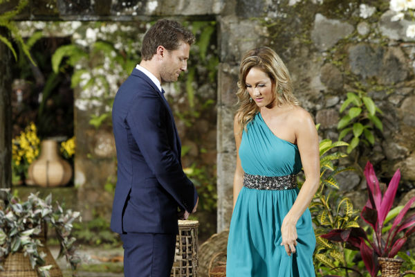 "<div class=""meta ""><span class=""caption-text "">Clare, one of two remaining finalists, prepares to leave a podium after telling star Juan Pablo Galavis off following his rejection of her, in a scene from the season 18 finale of ABC's 'The Bachelor,' which aired on March 10, 2014. (ABC Photo / Rick Rowell)</span></div>"