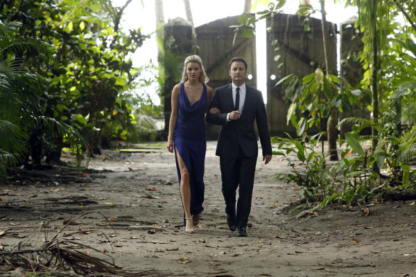 Nikki, the last remaining finalist, walks with host Chris Harrison in a in St. Lucia in a scene from the season 18 finale of ABC&#39;s &#39;The Bachelor,&#39; which aired on March 10, 2014. They are making their way to a podium, where she is expecting a proposal. <span class=meta>(ABC Photo &#47; Rick Rowell)</span>