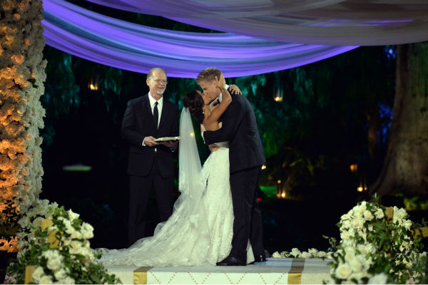 "<div class=""meta image-caption""><div class=""origin-logo origin-image ""><span></span></div><span class=""caption-text"">'The Bachelor' season 17 star Sean Lowe kisses his new bride Catherine Giudici at their wedding, officiated by Lowe's father Jay, an ordained minister, at the Four Seasons Biltmore hotel in Santa Barbara, California. The event aired live on TV as part of ABC's 'The Bachelor: Sean and Catherine's Wedding' special on Jan. 26, 2014. (ABC Photo / Todd Wawrychuk)</span></div>"