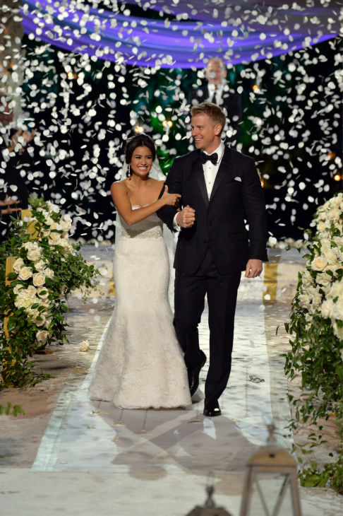 "<div class=""meta ""><span class=""caption-text "">'The Bachelor' season 17 star Sean Lowe and his new bride Catherine Giudici walk down the aisle after making their vows at their wedding at the Four Seasons Biltmore hotel in Santa Barbara, California. The event aired live on TV as part of ABC's 'The Bachelor: Sean and Catherine's Wedding' special on Jan. 26, 2014. (ABC Photo / Todd Wawrychuk)</span></div>"