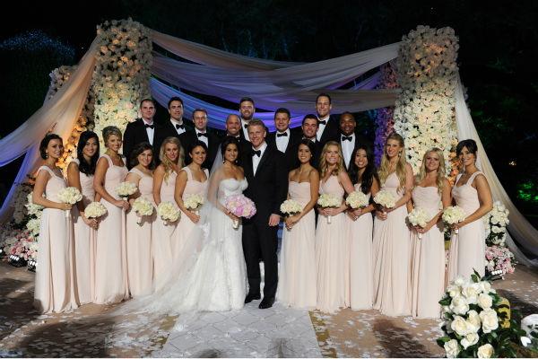 "<div class=""meta ""><span class=""caption-text "">'The Bachelor' season 17 star Sean Lowe, new bride Catherine Giudici and their bridesmaids and groomsmen appear at their wedding, which aired live on TV as part of ABC's 'The Bachelor: Sean and Catherine's Wedding' special on Jan. 26, 2014. (ABC Photo / Todd Wawrychuk)</span></div>"