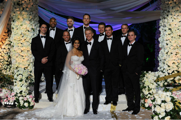 "<div class=""meta ""><span class=""caption-text "">'The Bachelor' season 17 star Sean Lowe and his new bride Catherine Giudici pose with their groomsmen at their wedding at the Four Seasons Biltmore hotel in Santa Barbara, California. The event aired live on TV as part of ABC's 'The Bachelor: Sean and Catherine's Wedding' special on Jan. 26, 2014. (ABC Photo / Todd Wawrychuk)</span></div>"