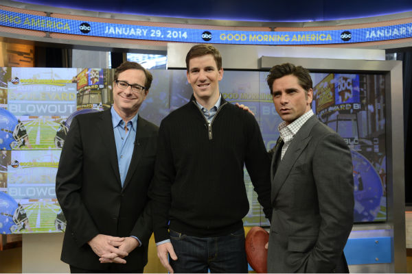 &#39;Full House&#39; stars John Stamos and Bob Saget pose with New York Giants Quarterback Eli Manning backstage at ABC&#39;s &#39;Good Morning America&#39; on Jan. 29, 2014. The actors were there to promote an Oikos Greek yogurt ad that will air during the Super Bowl on Sunday, Feb. 2. Manning&#39;s team is not taking part in it. <span class=meta>(ABC &#47; Ida Mae Astute)</span>
