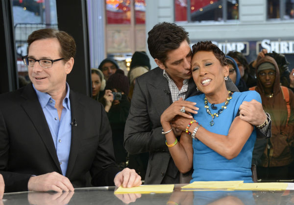 &#39;Full House&#39; star John Stamos kisses ABC&#39;s &#39;Good Morning America&#39; co-host Robin Roberts during a &#39;Full House&#39; mini-reunion on Jan. 29, 2014. Pictured left: Bob Saget. The actors were there to promote an Oikos Greek yogurt ad that will air during the Super Bowl on Sunday, Feb. 2. <span class=meta>(ABC &#47; Ida Mae Astute)</span>