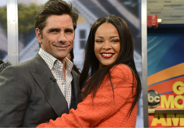 &#39;Full House&#39; alum John Stamos poses with fellow guest Rihanna on ABC&#39;s &#39;Good Morning America,&#39; which featured a &#39;Full House&#39; mini-reunion, on Jan. 29, 2014. He and former co-stars Bob Saget and Dave Coulier reunited on the show to promote an Oikos Greek yogurt ad that will air during the Super Bowl on Sunday, Feb. 2. <span class=meta>(ABC &#47; Ida Mae Astute)</span>