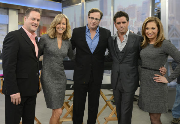 &#39;Full House&#39; alumni Dave Coulier, Bob Saget and John Stamos pose with ABC&#39;s &#39;Good Morning America&#39; personality Lara Spencer and weather anchor Ginger Zee on the show, which featured a &#39;Full House&#39; mini-reunion, on Jan. 29, 2014. The actors reunited on the program to promote an Oikos Greek yogurt ad that will air during the Super Bowl on Sunday, Feb. 2. <span class=meta>(ABC &#47; Ida Mae Astute)</span>