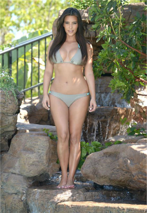 Kim Kardashian poses in a bikini at a pool in Miami on Dec. 14, 2012.