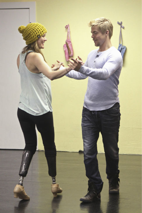 "<div class=""meta ""><span class=""caption-text "">'Dancing With The Stars' celebrity contestant Amy Purdy appears with partner Derek Hough at a reheasal before the season 18 premiere of the ABC show on March 17, 2014. Purdy is a double amputee and snowboarding champion who is the first Paralympian to compete on 'DWTS.' (ABC Photo / Adam Larkey)</span></div>"