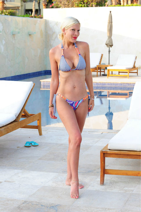 Tori Spelling poses in a bikini during a family vacation at the St Regis Punta Mita Resort in Mexico on May 20, 2013.
