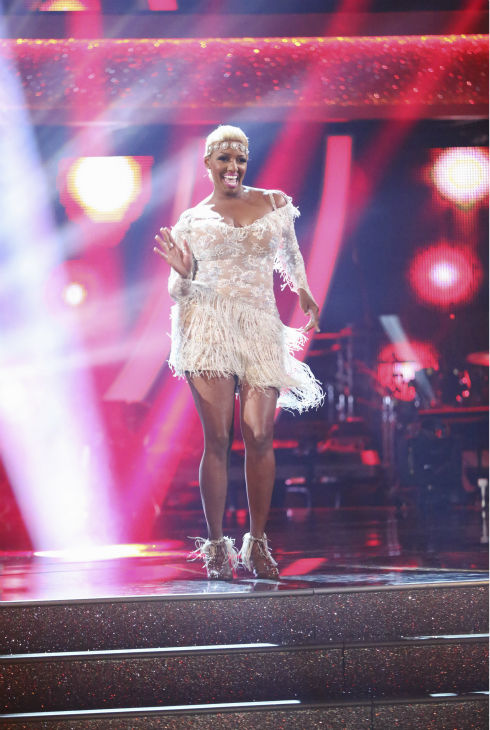 "<div class=""meta image-caption""><div class=""origin-logo origin-image ""><span></span></div><span class=""caption-text"">NeNe Leakes dances the Cha Cha Cha on week 1 of ABC's 'Dancing With The Stars' on March 17, 2014. She and partner Tony Dovolani received 21 out of 30 points from the judges. (ABC Photo / Adam Taylor)</span></div>"