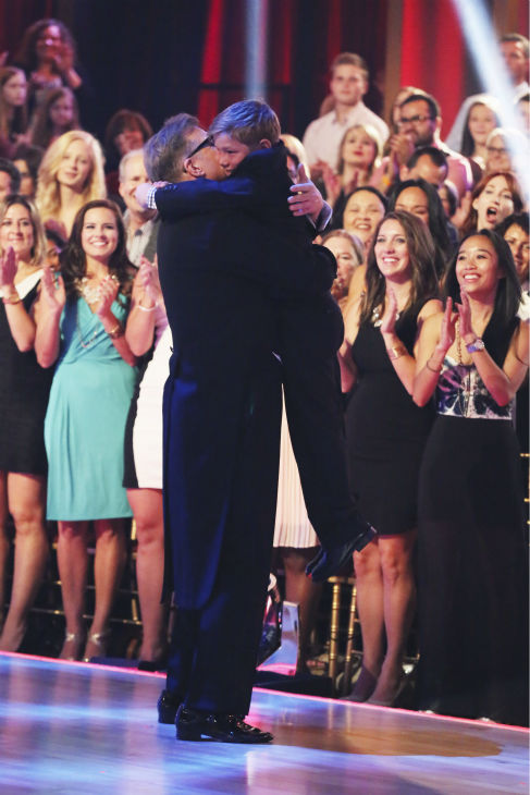 "<div class=""meta ""><span class=""caption-text "">Drew Carey hugs a boy during week 1 of ABC's 'Dancing With The Stars' on March 17, 2014. He and partner Cheryl Burke received 21 out of 30 points from the judges. (ABC Photo / Adam Taylor)</span></div>"