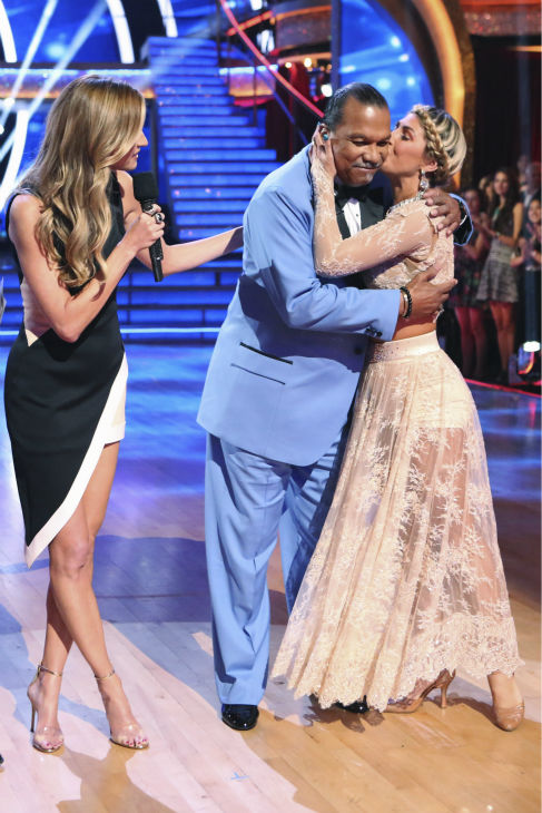 Billy Dee Williams and Emma Slater hug after it was announced they are exiting ABC&#39;s &#39;Dancing With The Stars&#39; as a result of Williams&#39; chronic back pain, during week 3 on March 31, 2014. Also pictured: Co-host Erin Andrews. <span class=meta>(ABC Photo &#47; Adam Taylor)</span>