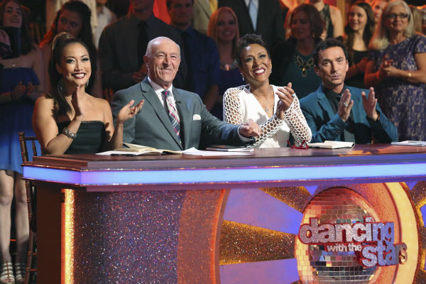"<div class=""meta ""><span class=""caption-text "">ABC's 'Dancing With The Stars' judges Carrie Ann Inaba, Len Goodman and Bruno Tonioli are joined by guest judge Robin Roberts (second from right) from the network's show 'Good Morning America' during week 3 of the ballroom dancing competition series on March 31, 2014. (ABC Photo / Adam Taylor)</span></div>"