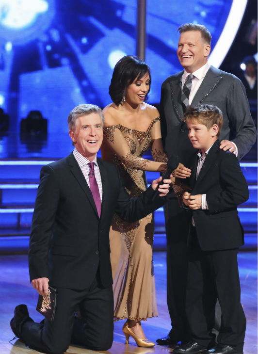 Drew Carey, pictured with his son, Connor, and partner Cheryl Burke await their fate on week 3 of ABC&#39;s &#39;Dancing With The Stars&#39; on March 31, 2014. They received 30 out of 40 points from the judges for their Waltz, which Carey dedicated to the boy. Also pictured: Co-host Tom Bergeron. <span class=meta>(ABC Photo &#47; Adam Taylor)</span>