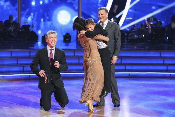 Drew Carey watches as partner Cheryl Burke hugs his son, Connor, on week 3 of ABC&#39;s &#39;Dancing With The Stars&#39; on March 31, 2014. They received 30 out of 40 points from the judges for their Waltz, which Carey dedicated to the boy. Also pictured: Co-host Tom Bergeron. <span class=meta>(ABC Photo &#47; Adam Taylor)</span>