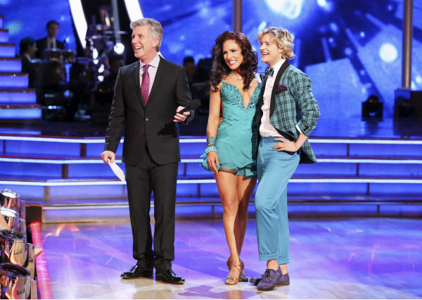 Charlie White and Sharna Burgess await their fate on week 3 of ABC&#39;s &#39;Dancing With The Stars&#39; on March 31, 2014. They received 36 out of 40 points from the judges for their Jive. Also pictured: Co-host Tom Bergeron. <span class=meta>(ABC Photo &#47; Adam Taylor)</span>